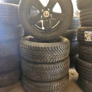 Honda 16 inch aluminum rims with snow tires